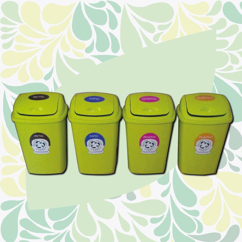 Foto de 4 tachos, uno para metal, otro para papel, otro para plástico y uno para residuos en general.